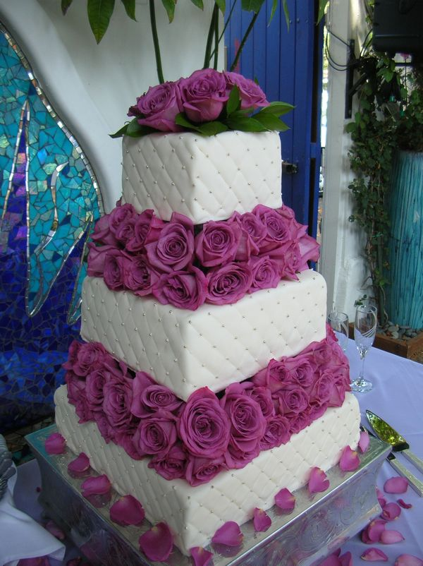 Naked cake with blue drip & beautiful blooms | African and